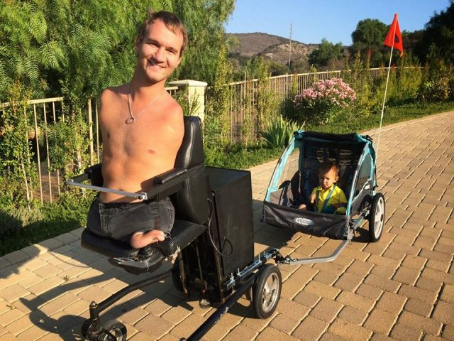 nick vujicic with his son